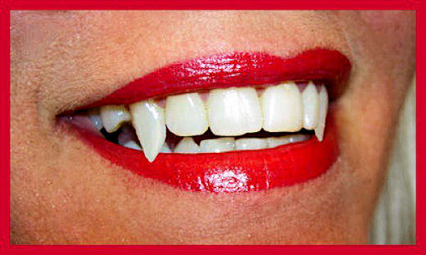 Vampire teeth from morgueFiles free photo license
